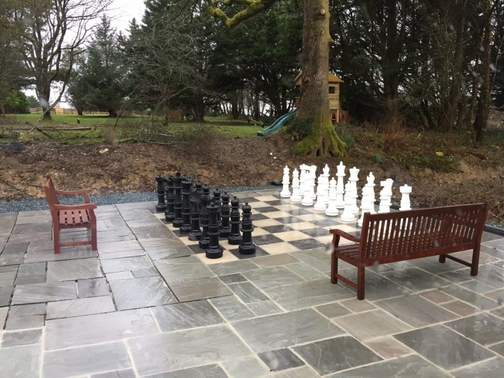 Giant Chess Set On Patio Area Next To Children's Play Area